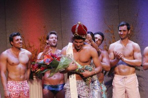 Mr. America is crowned.  Hot guys in Bathing suits.