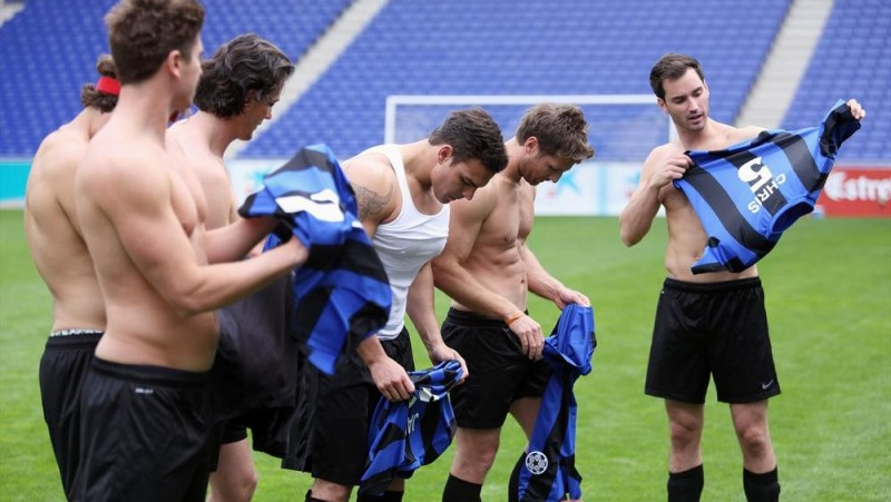 Guys go shirtless for the rough Soccer game.