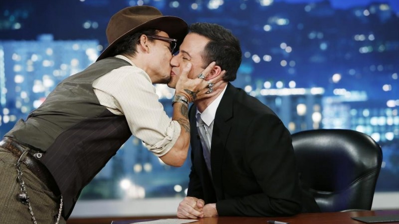 Jimmy Kimmel was surprised by Johnny Depp's affection when Depp planted three kisses on him